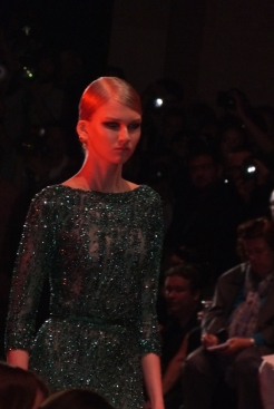This is an emerald green dress, standing perfectly in the Elie Saab style