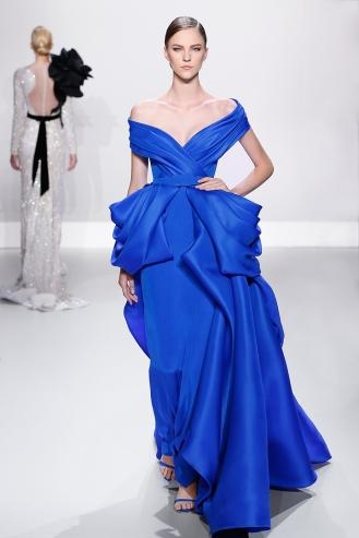 Royal blue silk gazar and crepe off- shoulder ballgown with bustle