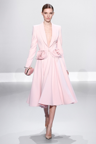 Pale pink silk wool jacket with rosette and flared skirt Dusky pink alligator box clutch with gold and bracelet handle