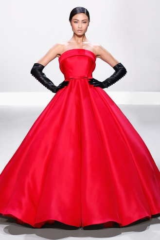 Raspberry red silk strapless gazar ballgown with soft roll collar and bow belt