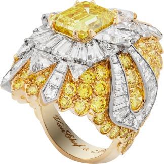 White gold, yellow gold, tapered and troidia-cut diamonds, round yellow diamonds, one emerald-cut Fancy Vivid Yellow diamond of 4.05 carats.
