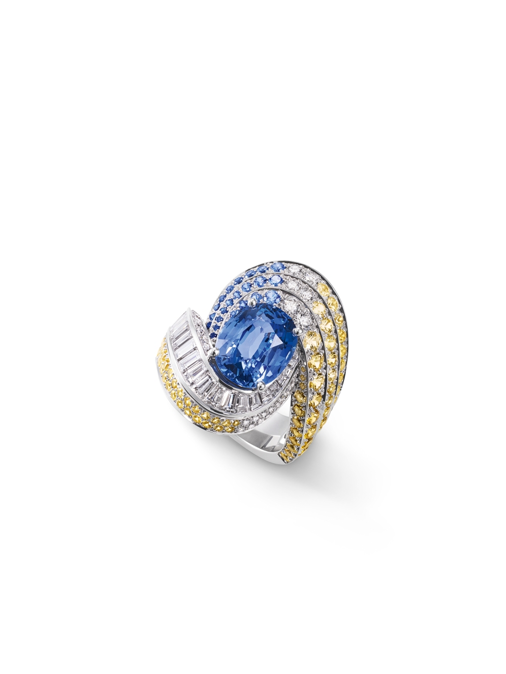 Ring in white gold, set with brilliant-cut, square-cut and baguette-cut diamonds, round blue and yellow sapphires and an oval-cut sapphire from Madagascar of 5.10 carats.