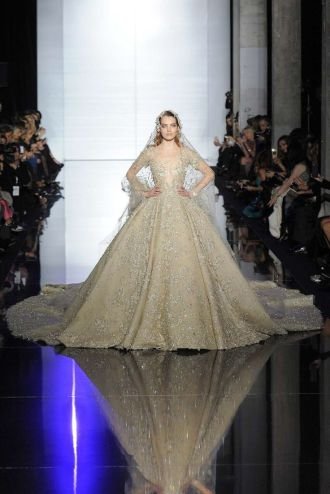 Winner: Bridals are a tradition in Parisian Haute Couture shows. It comes from the 1950s where already clients came to order their own marriage gown. Today, some designers decided to keep up with the tradition like Zuhair Murad. It seems Lebanese designers are definitely taking the turn of the bridal market. This dress is just beyond all expectations, embroideries certainly took months of work…